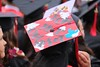 "Decorated caps send messages of gratitude at the Fall 2019 UH West O驶ahu Commencement ceremony on December 14, 2019.View more photos on the UH West Oahu Flickr site at: <a href=""http://www.flickr.com/photos/uhwestoahu/albums/72157712235251102"">www.flickr.com/photos/uhwestoahu/albums/72157712235251102</a>"