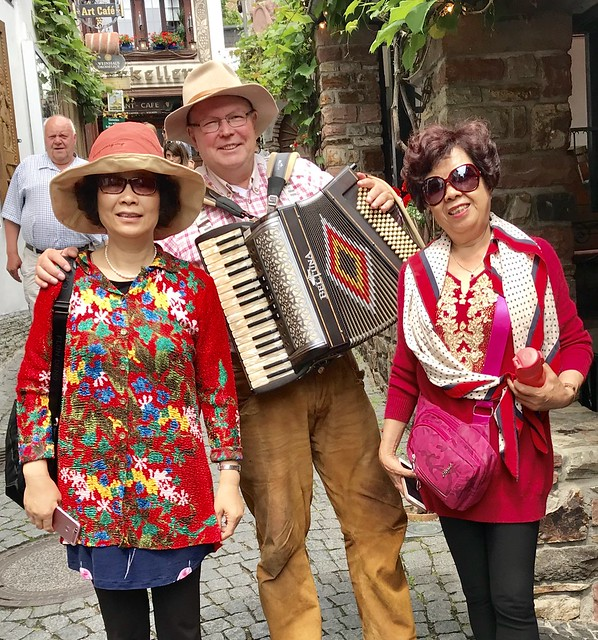 Drosselgasse in Ruedesheim at the River Rhine in Germany - Accordeonist and Tourists from Asia  - 2019