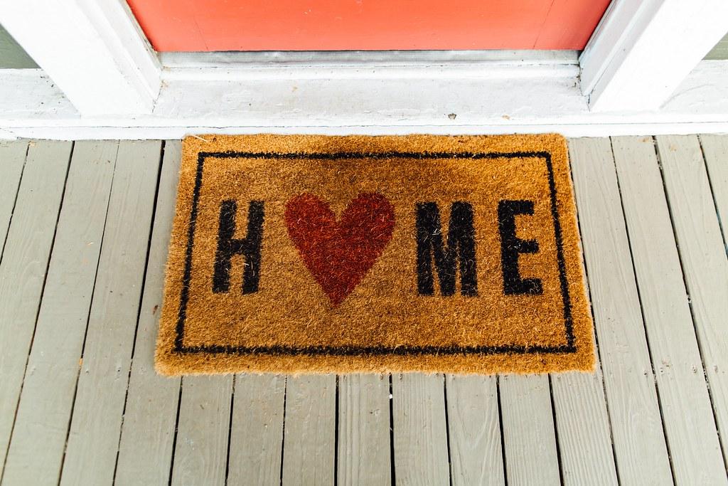 Brown home printed rug beside door - Credit to https://hom… | Flickr