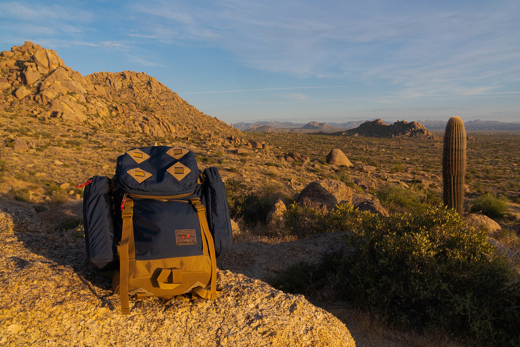 My Tom Bihn The Guide's Pack backpack sits on a rock on top of the Marcus Landslide at a scenic overlook on the Marcus Landslide Trail in McDowell Sonoran Preserve in Scottsdale, Arizona in November 2019