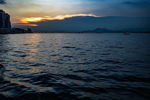 sunset water ocean sea buildings boats