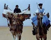 couple voyageant sur chameau