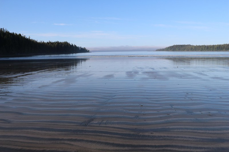 Blue Sky reflecting on the wavy wet sand at low tide on Pachena Bay as we begin our West Coast Trail hike