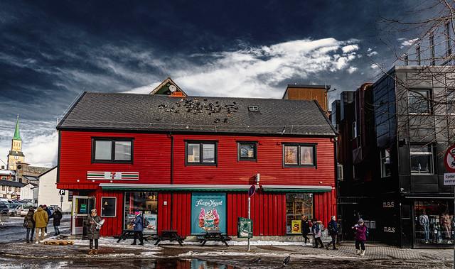 Winter view of wooden buildings in downtown shopping areas of Tromsø, Norway-32a