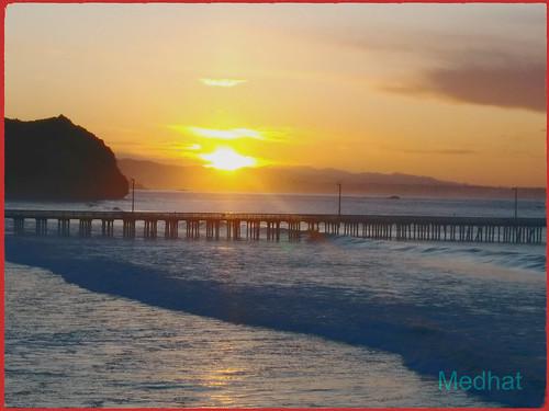 sunrise avilabeach pier surf waves water hills
