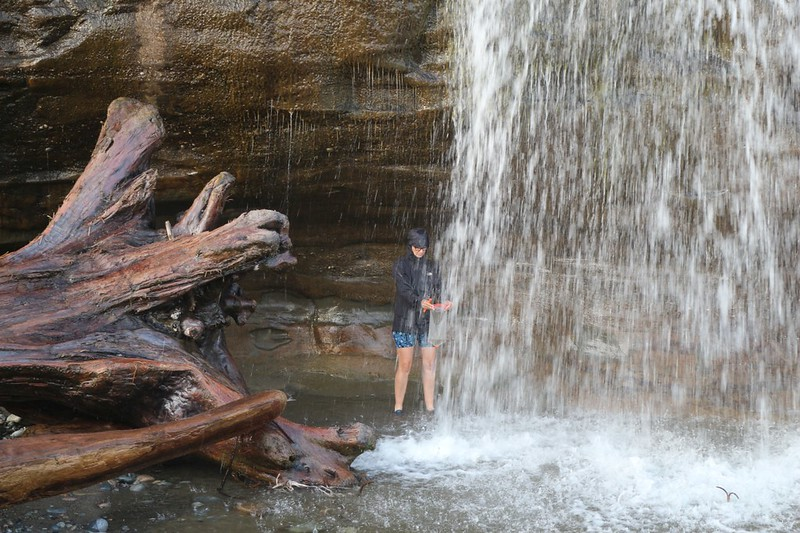 Vicki collected fresher water for filtering while standing behind the waterfall