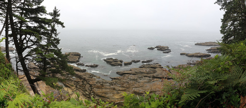 Panorama view of the rocky shore near the Valencia Bluffs from high up on the West Coast Trail