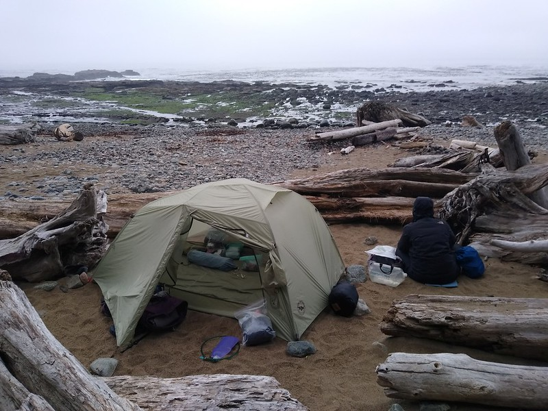 The best, softest, and safest spots to camp are up among the giant driftwood logs, far above the high-tide line