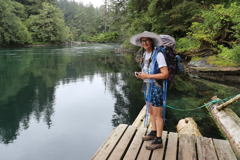 Vicki on the dock at Nitinat Narrows watching the river flow by as we wait for our boat ride