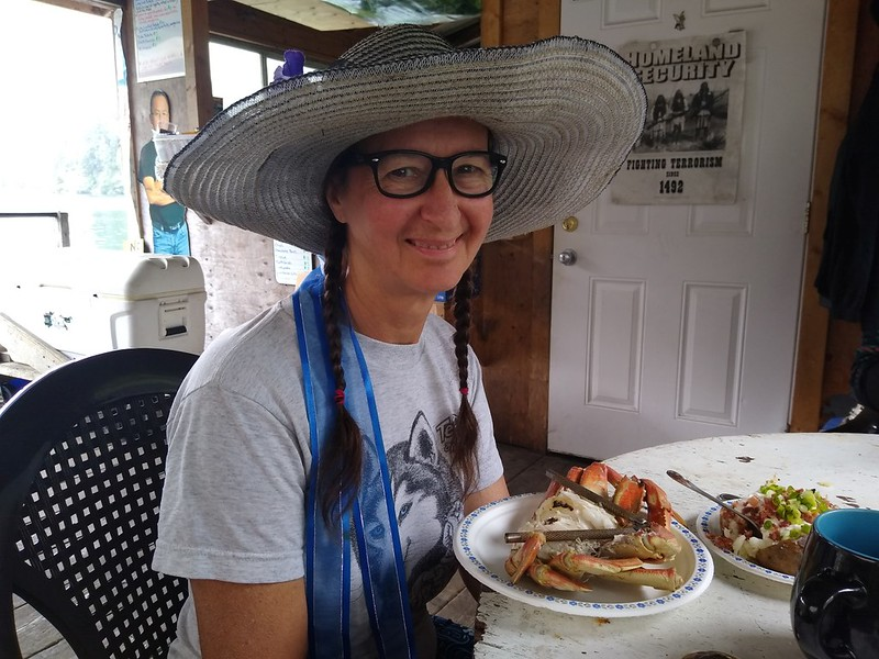 Happy Vicki eating her Dungeness Crab at Nitinat Narrows - much better than trail food!
