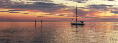boat yacht horizon sunset dusk fishing shore clouds channelmarkers waves reflections beautiful serene peaceful waterscape lights navigation motors signs pink blue yellow orange charlotteharbor charlottecounty puntagorda florida fl stevefrazierphotography mast dreamy calm serenity pano panorama evening furled sails sailor wake
