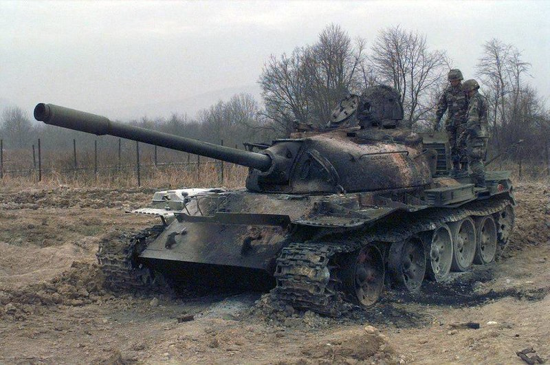 captain-price-official: A First Lieutenant from the 9th Engineer Battalion, and Staff Sergeant, from 2nd Ordnance EOD, assess a T-55 tank destroyed the day before at Camp Dobol, Bosnia, during Operation JOINT GUARD. 1996