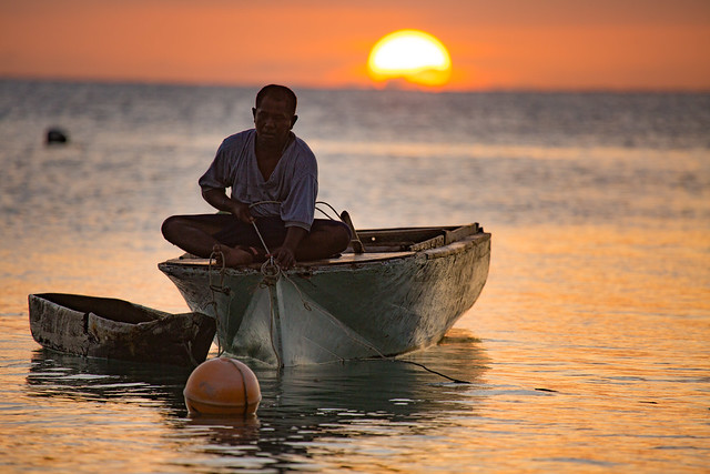 A Fisherman Pulls In His Catch On Mantanani Island, Borneo