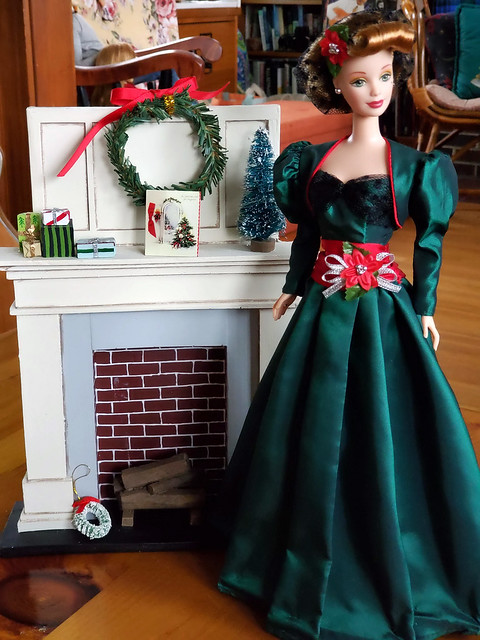 I cleaned up the dolls in the living room, on the coffee table and in the office.  Well, I made a stab at it, anyway.  Lol...  Just this lovely lady by the fireplace is left at the moment.  Hubby is enjoying the visual peace of less clutter.  :>)