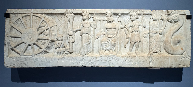Roman relief representing construction of the Capua theater, with gods