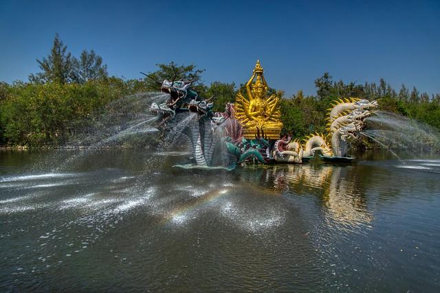Sculpture and fountain in a lake in Muang Boran in Samut Phrakan, Thailand