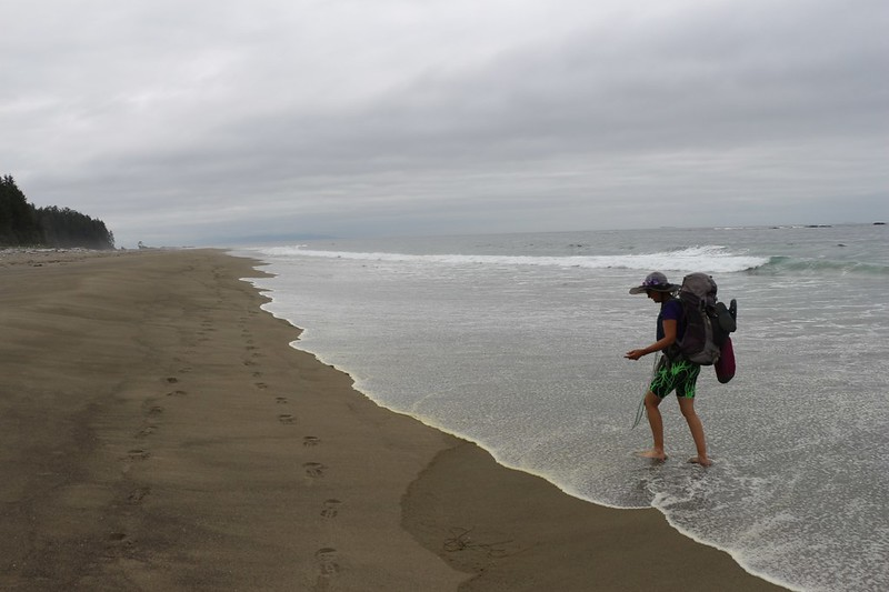 Vicki had happy feet in the cool waters of the Juan de Fuca Strait on the WCT south of the Cheewhat River