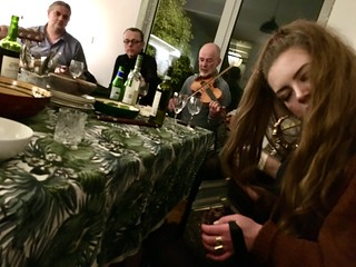 Playing jigs and reels at a kitchen session with twelve other musicians. | by adactio