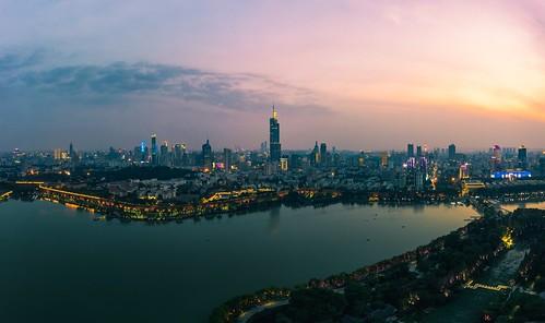 nanjing jiangsu peoplesrepublicofchina lake drone aerial city cityscape sky skyline skyscraper landscape landmark cloud horizon urban downtown light neon