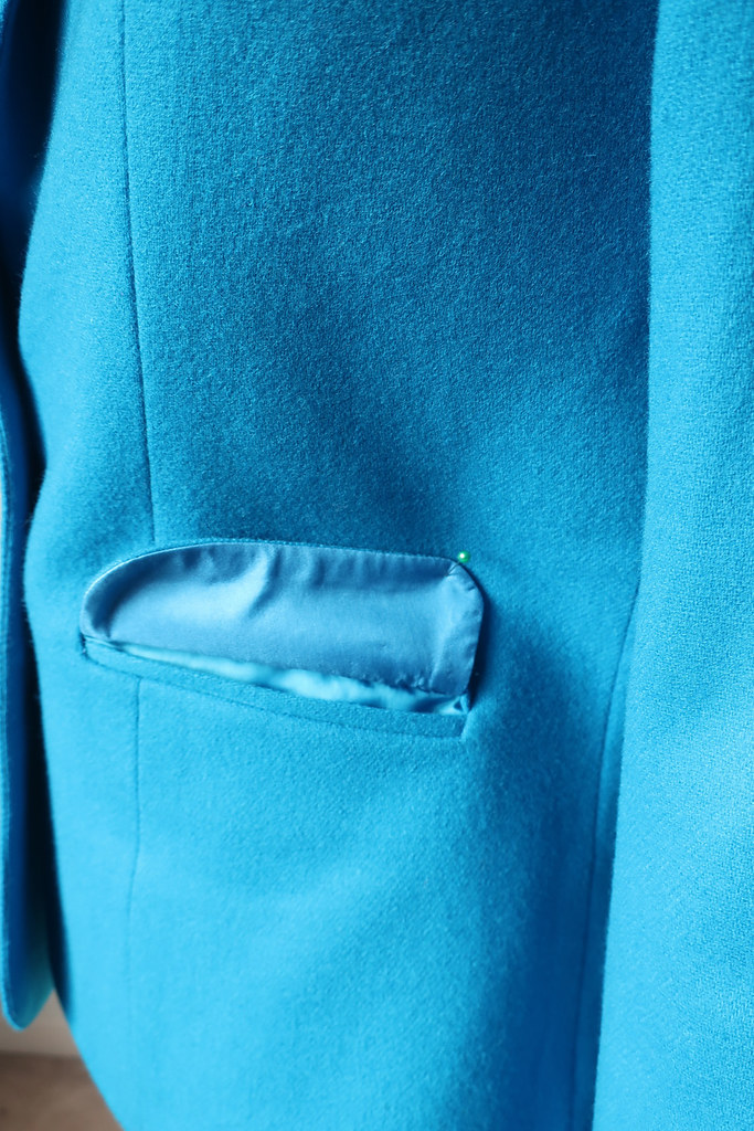 Blue jacket pocket flap
