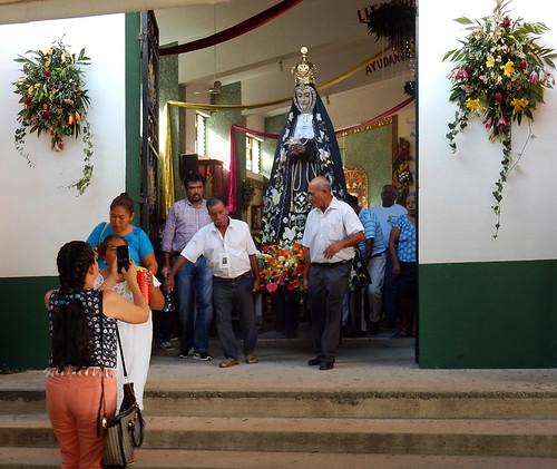 Carrying the Virgen de la Soledad out of the church in Puerto Escondido, Mexico