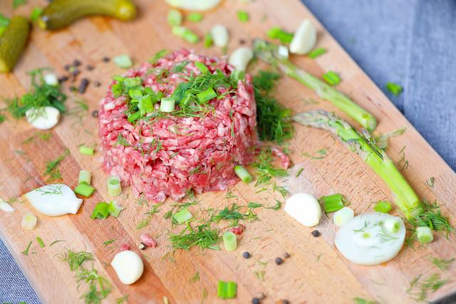 Beaff steak tartare on wooden background