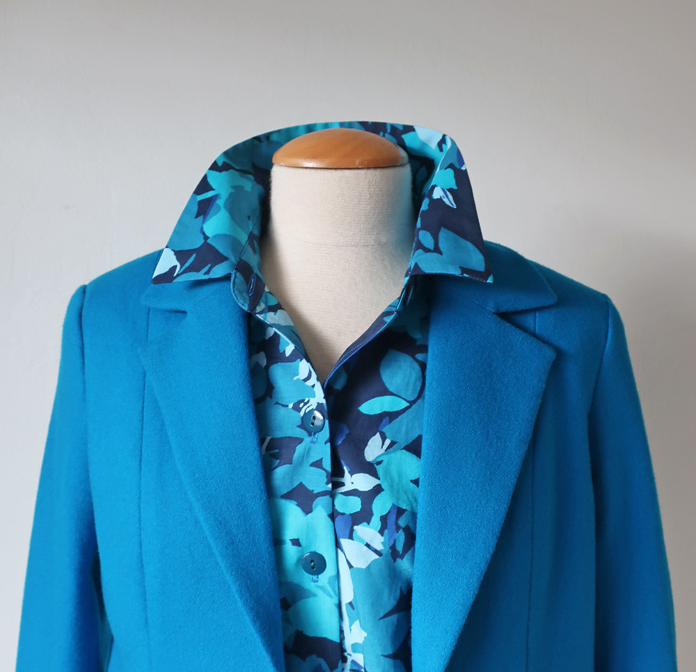 Blue jacket with cotton blouse