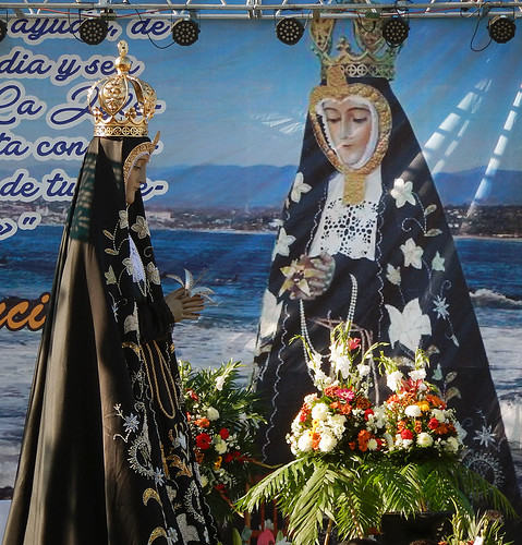 Carrying the Virgen de la Soledad out of the church in Puerto Escondido, Mexico