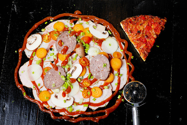 Italian pizza ingredients and pizza cutter