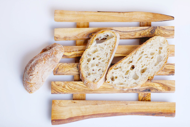 Slices of homemade bread, wooden chopper