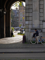 Free photo from Amsterdam city - a phone-break at the old city gate, picture by Fons Heijnsbroek, octtober 2018