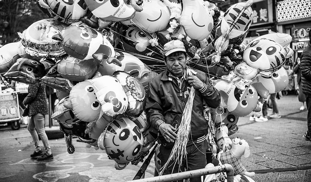 selling balloons outside the temple