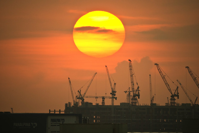 Sunset and tower cranes