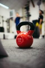 Red kettlebells weighing 16 kilograms