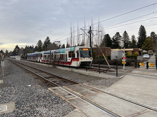 A southbound train approaches Washington Street in downtown Milwaukie
