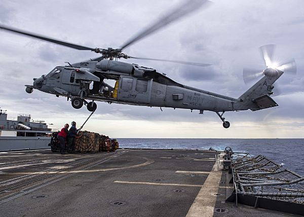 retrowar: MH-60S Sea Hawk helicopter attached to the Dragon Slayers of Helicopter Sea Combat Squadron (HSC) 11 on the flight deck of the Ticonderoga-class guided- missile cruiser USS Normandy (CG 60)