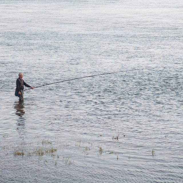 Fisherman in the river Angara - 1x1