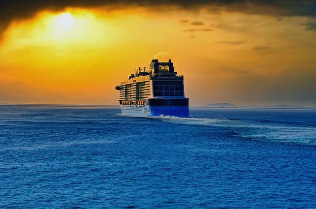 A distant ship's smoke on the horizon