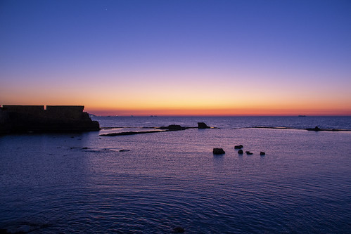 sunset colors orange beach water blue dark evening