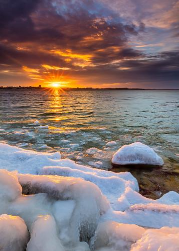 nature sunset madison wisconsin rocks ice lakemendota clouds sky sun canoneos5dmarkiv canonef1635mmf4lis leefilters100mmreversegraduated12neutraldensity4stopfilter vertical unitedstatesofamerica