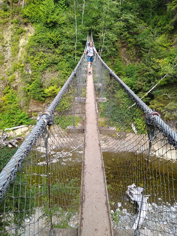Looking back at Vicki as she crosses the suspension bridge over Logan Creek on the West Coast Trail