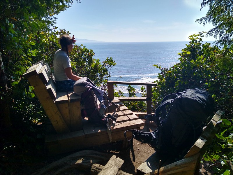 We rested at some wooden benches with beautiful views, and Vicki tried to dry out her shoes