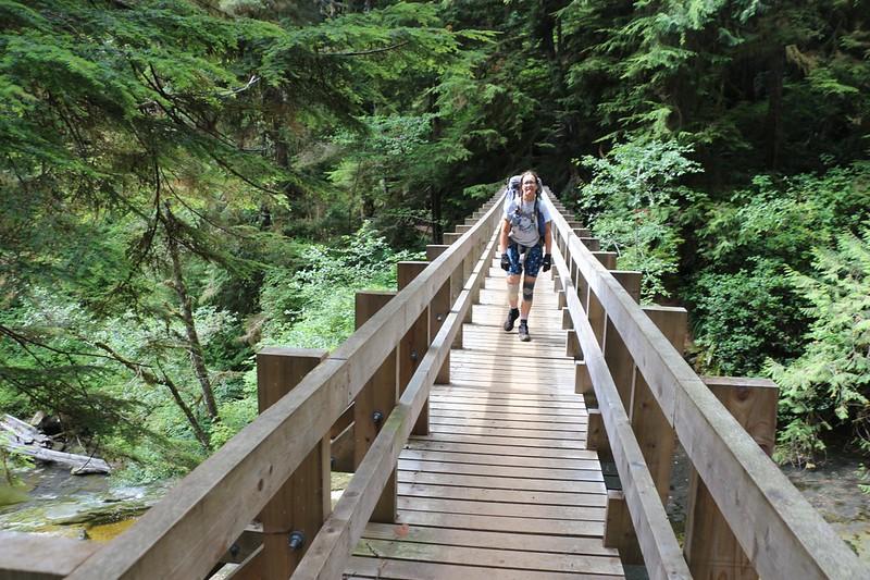Walking across the long wooden and steel bridge over Sandstone Creek