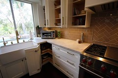 Transitional Design Build complete kitchen remodel with custom Aplus cabinets & wood floor in Anaheim Hills, Orange County. https://www.aplushomeimprovements.com/portfolio_page/136-transitional-design-build-kitchen-remodel-in-anaheim-hill-orange-county/