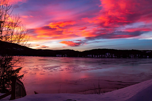 countryside lake norway sunset clouds forest ice snow trees winter ørfiske