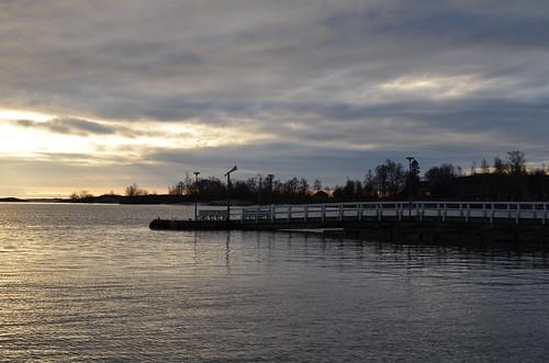 finand helsinki kaivopuisto sea winter pier sky horizon clouds view water tree noon