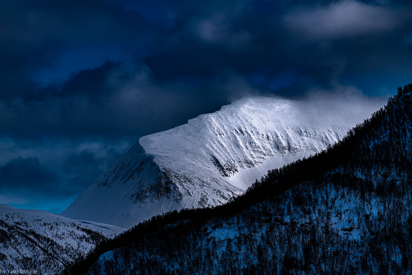 This is Tromsdalstinden, a prominent peak east of Tromso, Norway- 51