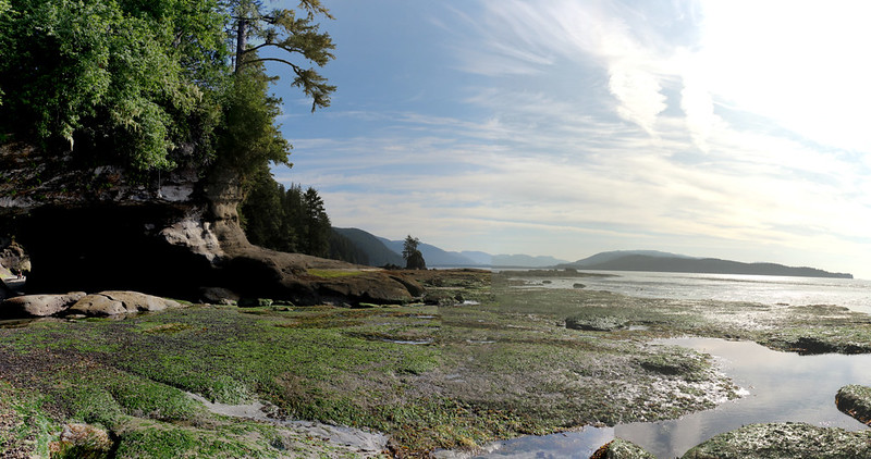Panorama shot with the hole in the rock on the far left and Port Renfrew in the distance