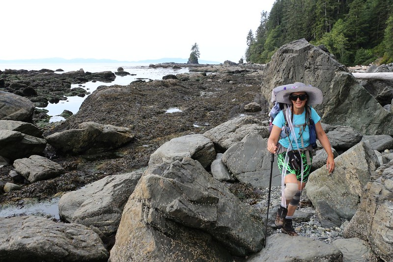Vicki climbing on the boulder-strewn coastline between Owen Point and Thrasher Cove on the West Coast Trail