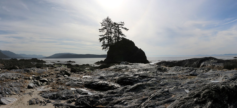 Panorama view of Port San Juan with a tiny tidal islet on the coast near Owen Point on the West Coast Trail